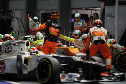 Nico Hulkenberg, Sahara Force India F1 makes a pit stop as Sergio Perez, Sauber pulls into his pit box