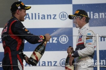 First place for Sebastian Vettel, Red Bull Racing and third for Kamui Kobayashi, Sauber F1 Team