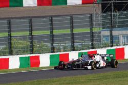Lewis Hamilton, McLaren and Sergio Perez, Sauber battle for position