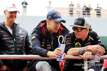 Michael Schumacher, Mercedes AMG F1 with Sebastian Vettel, Red Bull Racing and Kimi Raikkonen, Lotus F1 Team on the drivers parade