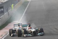 Michael Schumacher, Mercedes AMG F1 leads Sergio Perez, Sauber