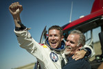 Felix Baumgartner celebrates after jumping from 128,000 feet and breaking the speed of sound