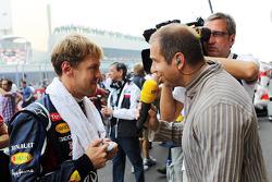 Sebastian Vettel, Red Bull Racing with Kai Ebel, RTL TV Presenter on the grid