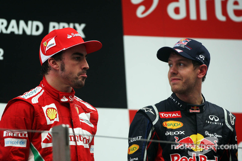 Fernando Alonso, Ferrari with race winner Sebastian Vettel, Red Bull Racing on the podium