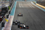 Narain Karthikeyan, HRT Formula One Team HRT F112 leads Bruno Senna, Williams and Sebastian Vettel, Red Bull Racing