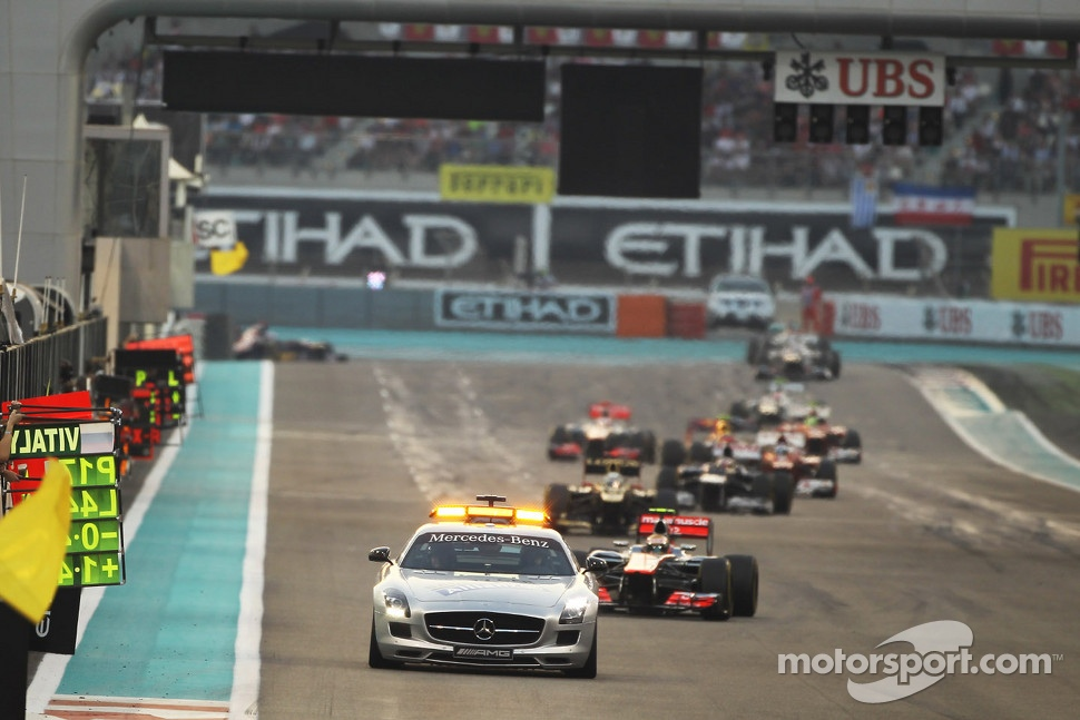Lewis Hamilton, McLaren leads behind the Safety Car