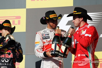 The podium: Sebastian Vettel Red Bull Racing, second; Lewis Hamilton, McLaren, race winner; Fernando Alonso, Ferrari, third