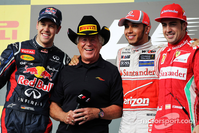The podium: Sebastian Vettel, Red Bull Racing, second; Mario Andretti, Lewis Hamilton, McLaren, race winner; Fernando Alonso, Ferrari, third