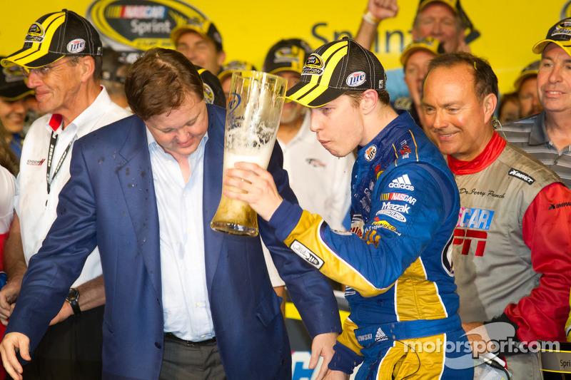 Championship victory lane: 2012 NASCAR Sprint Cup Series champion Brad Keselowski, Penske Racing Dodge celebrates with Brian France