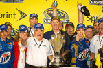 Championship victory lane: 2012 NASCAR Sprint Cup Series champion Brad Keselowski, Penske Racing Dodge celebrates with Roger Penske and his team