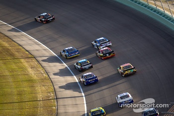 Marcos Ambrose, Richard Petty Motorsports Ford leads a group of cars