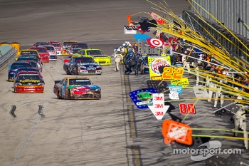 Kyle Busch, Joe Gibbs Racing Toyota leads the field on pitlane