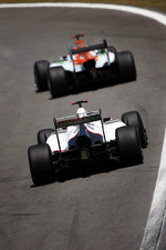 Paul di Resta, Sahara Force India leads Kamui Kobayashi, Sauber