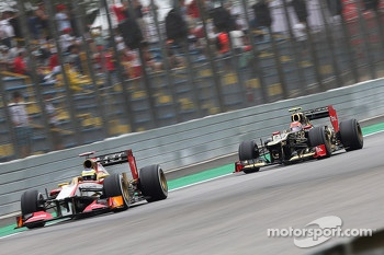 Pedro De La Rosa, HRT Formula 1 Team leads Romain Grosjean, Lotus F1 shortly before they made contact in qualifying