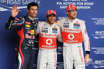 Qualifying parc ferme, Mark Webber, Red Bull Racing, third; Lewis Hamilton, McLaren, pole position; Jenson Button, McLaren, second