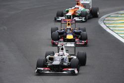Kamui Kobayashi, Sauber leads Sebastian Vettel, Red Bull Racing