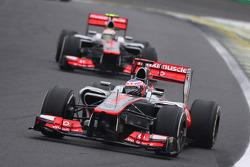 Jenson Button, McLaren leds team mate Lewis Hamilton, McLaren