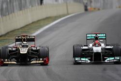 Kimi Raikkonen, Lotus F1 Team and Michael Schumacher, Mercedes GP