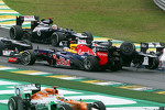 Sebastian Vettel, Red Bull Racing survives a crash with Bruno Senna, Williams at the start of the race