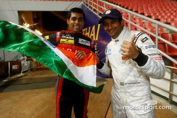 Karun Chandhok and Narain Karthikeyan celebrate their ROC Asia win for Team India