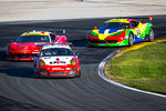 #62 Snow Racing/Wright Motorsports Porsche GT3: Madison Snow, Melanie Snow, Marco Seefried, Sascha Maassen, Klaus Bachler, #61 R.Ferri/AIM Motorsport Racing with Ferrari Ferrari 458: Max Papis, Jeff Segal, Toni Vilander, Giancarlo Fisichella, #64 Scuderia