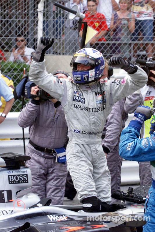 Race winner David Coulthard celebrates