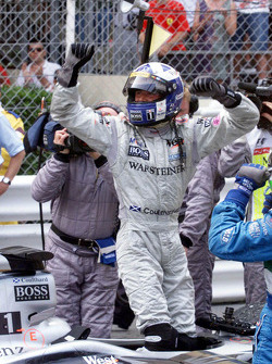 Race winner David Coulthard celebrates