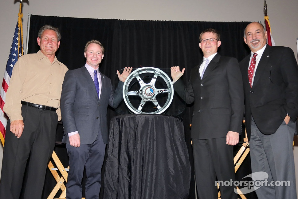 Cliff White is presented with annual RRDC Mark Donohue Award from Dorsey Schroeder, David Donohue and Bobby Rahal