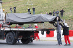 The Sauber C32 of Esteban Gutierrez, Sauber is recovered back to the pits on the back of a truck