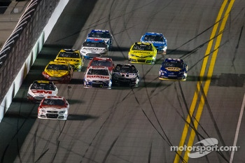 Kevin Harvick, Richard Childress Racing Chevrolet leads the field while Dale Earnhardt Jr., Hendrick Motorsports Chevrolet and Tony Stewart, Stewart-Haas Racing Chevrolet touch at the back
