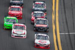 Joe Nemechek and Kurt Busch lead a group of cars