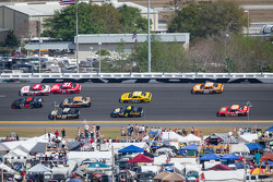 Kurt Busch and Mike Harmon lead a group of cars