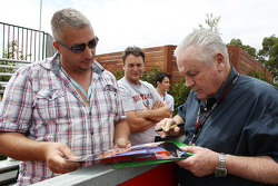 Alan Jones, signs autographs for the fans