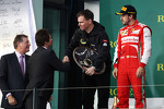 Alan Permane, Renault Race Engineer collects his trophy on the podium from Arnaud Boetsch, Rolex Communication and Image Director