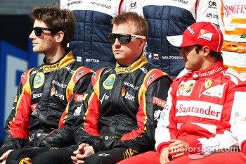 (L to R): Romain Grosjean, Lotus F1 Team; Kimi Raikkonen, Lotus F1 Team and Felipe Massa, Ferrari at the start of year drivers photo