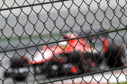 Jules Bianchi, Marussia F1 Team MR02 passes a lizard on the fencing