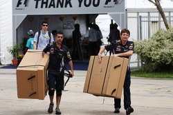 Red Bull Racing mechanics with big cardboard boxes