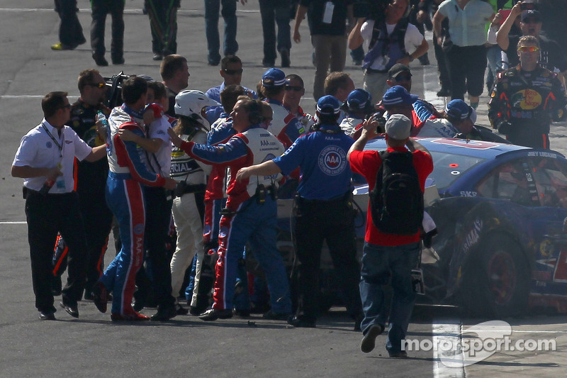 Joey Logano, Penske Racing Ford is held back after an altercation with Tony Stewart