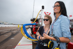 Kirsten Dee, girlfriend of James Hinchcliffe, watches the end of the race with Holly Wheldon