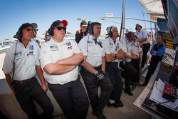 Alex Job Racing team members watch qualifying