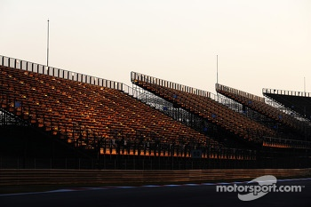 The sun sets on a track grandstand