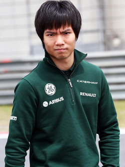 Ma Qing Hua, Caterham F1 Reserve Driver walks the circuit