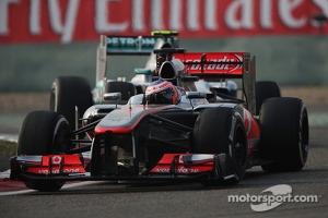 Jenson Button, McLaren MP4-28 leads Nico Rosberg, Mercedes AMG F1 W04