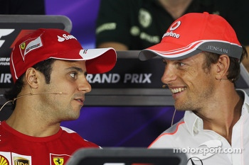(L to R): Felipe Massa, Ferrari and Jenson Button, McLaren in the FIA Press Conference