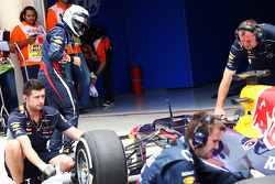 Sebastian Vettel, checks his  Red Bull Racing RB9 after he ran wide at the end of the third practice session