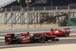 Fernando Alonso, Ferrari F138 spins in the third practice session and is passed by Romain Grosjean, Lotus F1 E21