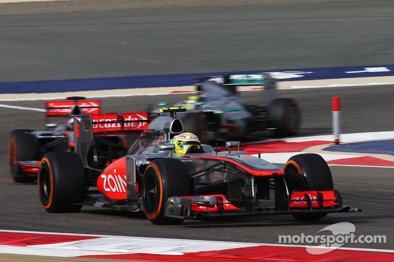 Sergio Perez, McLaren MP4-28 leads team mate Jenson Button, McLaren MP4-28