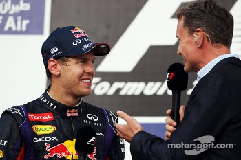 Race winner Sebastian Vettel, Red Bull Racing on the podium with David Coulthard, Red Bull Racing and Scuderia Toro Advisor / BBC Television Commentator