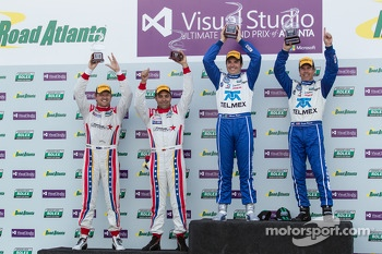 Overall podium: winners Scott Pruett and Memo Rojas, second place Ryan Dalziel, Alex Popow