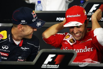 (L to R): Sebastian Vettel, Red Bull Racing with Fernando Alonso, Ferrari in the FIA Press Conference